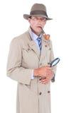 Espião que olha através da lente de aumento Fotografia de Stock Royalty Free
