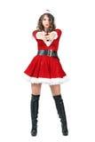 Espion féminin déguisé comme Santa Claus avec le hoodie visant l'arme à feu l'appareil-photo Photo stock