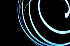 Espiral de ne?n en el fon oscuro imágenes de archivo libres de regalías