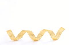 Espiral de oro de la cinta Imagen de archivo libre de regalías