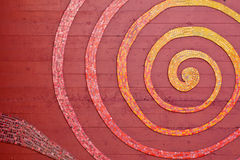 Espiral del mosaico en la pared Fotografía de archivo
