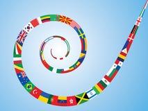 Espiral feita de bandeiras do mundo Fotografia de Stock Royalty Free