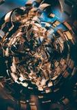 Espiral moderno del metal del oro Imágenes de archivo libres de regalías