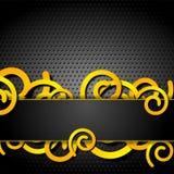 Espirales anaranjados en fondo perforado gris oscuro Imagen de archivo libre de regalías