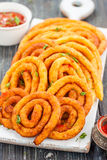 Espirales de la patata y del queso en aceite Imagen de archivo libre de regalías