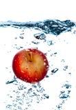 Espirrando a maçã. Fotos de Stock