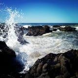 Espirrando o oceano fotografia de stock royalty free