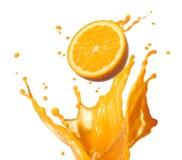 Espirrando o suco de laranja Foto de Stock Royalty Free