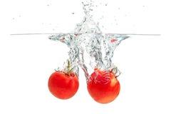 Espirrando tomates Imagens de Stock