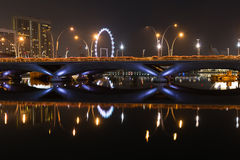 Esplanade bridge, theater and Singapore Flyer at night Stock Photos