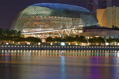 Esplanade Dome. One of the twin domes of the Esplanade Theater complex, a landmark of Singapore at Marina Bay.  Night view across the river with light trails of Stock Photography