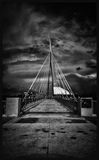 Esplanade Riel. A black and white photo of a the Esplanade Riel in Winnipeg, Canada with an ominous storm cloud in the sky royalty free stock photography