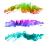Esplosione delle polveri colorate su fondo bianco Fotografia Stock