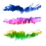 Esplosione delle polveri colorate su fondo bianco Immagini Stock