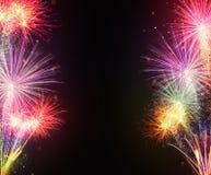 Esplosioni dei fuochi d'artificio su fondo nero Fotografia Stock