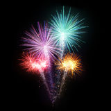Esplosioni dei fuochi d'artificio su fondo nero Immagini Stock Libere da Diritti