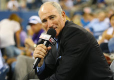 ESPN analyst Brad Gilbert comments match between Serena Williams and Taylor Townsend at US Open 2014. NEW YORK - AUGUST 26 ESPN analyst Brad Gilbert comments stock photography