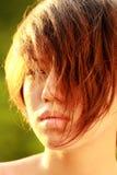 Esponga al sole il ritratto di un Coreano afflitto, mèche del fronte della copertura dei capelli Immagine Stock Libera da Diritti