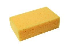 Esponja amarilla en blanco Imagen de archivo