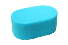 Esponja azul en blanco foto de archivo