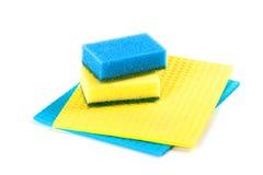 Esponjas azules y amarillas Fotos de archivo libres de regalías