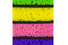 Esponjas coloridas coloridas em um fundo branco Fotografia de Stock