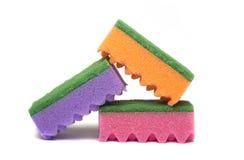 Esponjas coloridas isoladas Fotografia de Stock