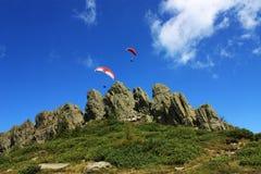 Esportes extremos no papel de parede das montanhas rochosas Fotografia de Stock Royalty Free