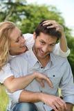 Esposa que juega con el pelo del marido Imagen de archivo libre de regalías