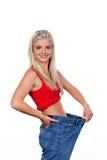 Esposa a una dieta acertada con los pantalones grandes Foto de archivo libre de regalías