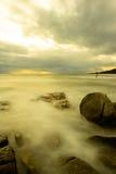 Esposizione lunga di tramonto della spiaggia Fotografia Stock