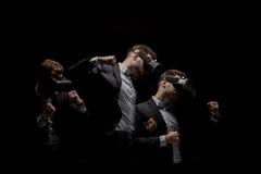 Esposizione multipla dell'uomo d'affari che perfora e che per mezzo della cuffia avricolare di realtà virtuale Fotografia Stock Libera da Diritti