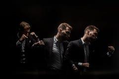 Esposizione multipla dell'uomo d'affari che perfora qualcuno Fotografia Stock Libera da Diritti