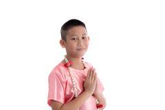 Espressione asiatica Sawasdee di benvenuto del ragazzo Fotografia Stock Libera da Diritti