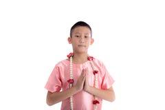 Espressione asiatica Sawasdee di benvenuto del ragazzo Immagine Stock