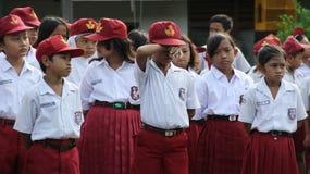 Espressione degli scolari quando forniscono il primo giorno di sch Fotografia Stock