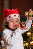 Espressione di gioia di natale sul fronte del bambino Immagine Stock Libera da Diritti