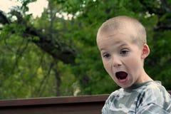 Espressioni 3 del ragazzo immagine stock
