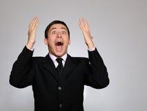 Espressioni. Giovane uomo di affari che grida Fotografia Stock