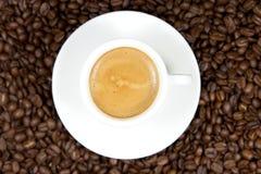 Espresso. A cup of Espresso over cofe beans stock image