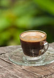 Espresso. Cup of espresso on wooden table Royalty Free Stock Photography