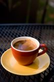 Espresso. A cup of espresso outside on a table in warm morning light Stock Photo