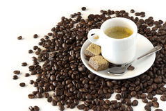 Espresso. Coffee with cookies over roasted coffee beans Stock Photo
