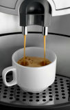 Espresso. Macro shot of espresso flowing into a cup royalty free stock images