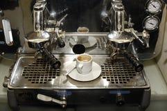 Espresso. Antique espresso machine and espresso coffee cup just made Royalty Free Stock Photos