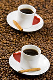 Espresso. Served on heart shaped cup on coffee beans stock images
