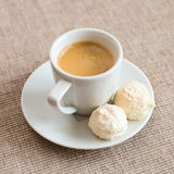 Espresso. Cup of espresso with kiss cookies. Shallow depth of field Stock Images