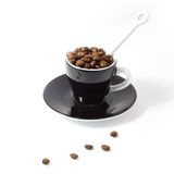 Espresso Beans in a Cup Royalty Free Stock Image