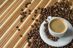 Espresso and beans. Cup of espresso and coffee beans Royalty Free Stock Photo