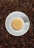 Espresso and beans up. Cup of espresso and coffee beans upright Stock Photography